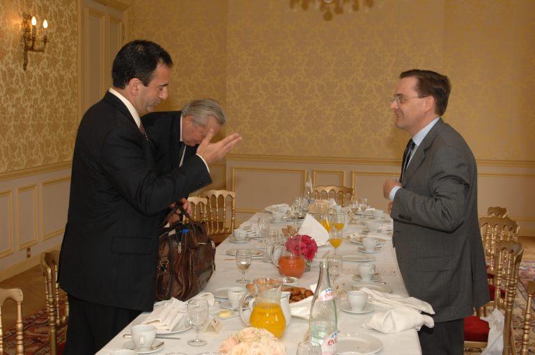 Fabien Baussart with U.S. diplomat Philip Gorden.